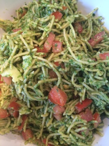 Ideal dinner: Whole wheat pasta, olive oil, tomatoes, and ground kale.